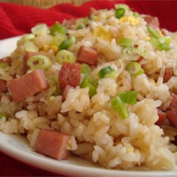 Island-Style Fried Rice Recipe - Fried rice, Hawaiian-style, features such beloved island delicacies as pineapple, Chinese lup cheong sausage, and that famous luncheon meat in the rounded-off cans.