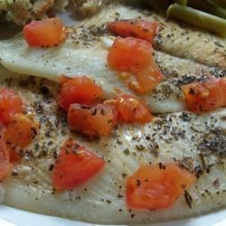 Italian Style Flounder Recipe - In this simple preparation, baked flounder fillets take on a delicious Italian-inspired flavor.