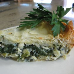 Spanakopita (Greek Spinach Pie) Recipe - This is an authentic, really rich pie stuffed with spinach, onions, cheeses and herbs that are all enfolded by crispy, flaky phyllo dough.