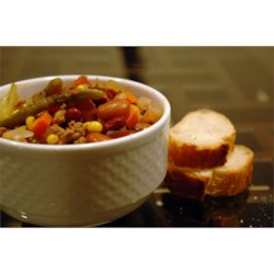 Italian Vegetable Soup Recipe - Carrots, celery, onions, cabbage, corn, and green beans -- this soup is full of vegetables!  With ground beef, beans, and macaroni, a loaf of warm, crusty bread is all you need for a well-rounded dinner.
