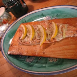 Canadian Cedar Planked Salmon Recipe - The salmon is slow cooked, which produces a rich, smoky flavor. Guests enjoy the wonderful taste of this specially prepared salmon. The plank must be soaked overnight before use. Be sure to use wood that has not been treated with any chemicals.