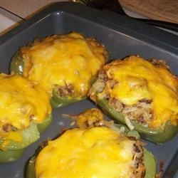 Hash Brown Hot Dish Stuffed Bell Peppers Recipe - Bell peppers stuffed with hashbrowns, ground beef, green beans, and cheese.  My apartment-mate and I invented this recipe while drinking beer and 'reminiscing' about elementary-school cafeteria food!