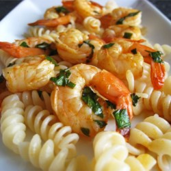 Zippy Summer Shrimp Recipe - This quick preparation of shrimp pan-fried with garlic, red pepper flakes, lemon juice, and basil goes with any of a number of meal accompaniments.