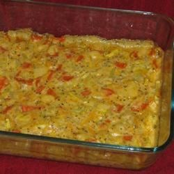Granny's Squash Casserole Recipe - This one has been passed down for generations! Tender squash is baked with a variety of sumptuous flavors to create a veritable cornucopia of delight.