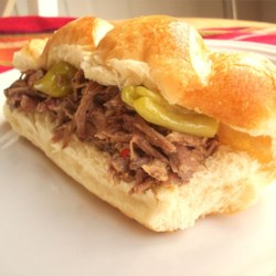 Original Homemade Italian Beef Recipe and Video - Chuck roast is slow-cooked with Italian salad dressing mix and pickled peppers until it is tender enough to shred with a fork.