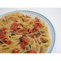 Pasta with Fresh Tomato Sauce Recipe and Video - This very quick pasta dish uses fresh tomatoes and basil tossed with Italian salad dressing and Parmesan cheese. It's a great meal to prepare in the summer after a long day in the garden!