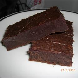 Fudgy Brownies II Recipe - Simple brownies that pack a powerful chocolate wallop! Easy to make and only a few ingredients.