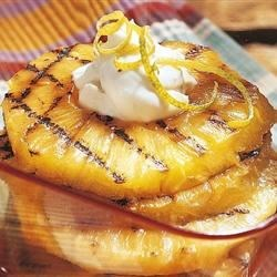 Grilled Pineapple with Mascarpone Cream Recipe - Use your grill to make this easy, elegant dessert of grilled pineapple slices served with lemon-scented mascarpone cheese and a sprinkling of toasted hazelnuts.
