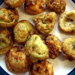 Tia and David's Deep Fried Tortellini Recipe - Real party pleasers, these cheese tortellini are shaken up with bread and cornflake crumbs, then deep-fried to a mouth-watering golden brown. Try them dipped in tomato sauce!