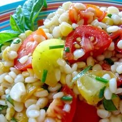 Pasta with Fresh Tomatoes and Corn Recipe - Taste a late summer harvest in a colorful pasta sauce that needs no cooking. Simply stir cooked corn, chopped tomatoes and sliced green onions into a dressing of olive oil, red wine vinegar and basil. Toss with hot pasta and sprinkle with Parmesan.