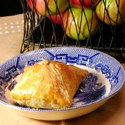 Allie's Delicious Baked Dumplings Recipe - Tart apples are seasoned with cinnamon, sugar and nutmeg, then baked in puff pastry and drizzled with icing.