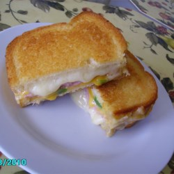Spicy Ham and Grilled Cheese Sandwich Recipe - Served on rye bread, this ham and cheese sandwich gets its unusual, spicy kick from a green chile pepper.