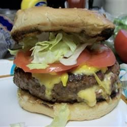 Stuffed Burgers Recipe - Big juicy burgers filled with chilies, cheese and mushrooms, then grilled and basted with steak sauce. Use any type of cheese you like. When I have a cook out, and I'm making burgers, this is what my wife asks for all the time!