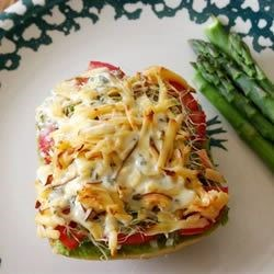The Best Veggie Sandwich Recipe - English muffins are layered with avocado, sprouts, tomato, Ranch dressing, sesame seeds and smoked Cheddar, then lightly broiled.  Garnish each with a black olive, if desired.