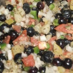 Blueberry Salsa Recipe - Blueberries and spice - this salsa is very nice. Crushed and whole blueberries are combined with jalapeno pepper, red onion, and fresh lime juice to make a tasty salsa to serve with tortilla chips or as a topping for grilled meats.