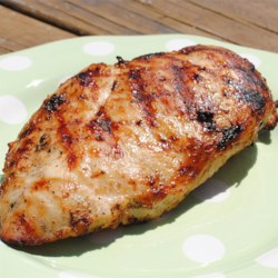 Garlic Herbed Chicken Recipe - Chicken is grilled with a garlic and tarragon mixture that will make your mouth water!