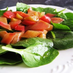 Rhubarb Spinach Salad Recipe - Rhubarb flavors a hot dressing to pour over a delightful wilted spinach salad for spring.