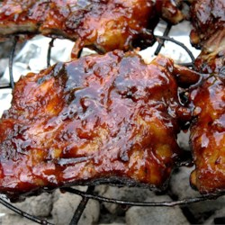 Barbequed Ribs Recipe - These pork ribs require a double cooking process and an overnight bath in a marinade. The spicy rub and rich sauce make them worth the wait!