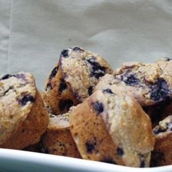 Black and Blueberry Muffins Recipe - These are moist and sweet, and full of berries - and in my opinion are much better than plain blueberry muffins. My two children cannot get enough of them, and often bring me berries they have picked to make these muffins. The muffins are made with whole wheat flour and wheat germ, but the kids do not seem to notice.