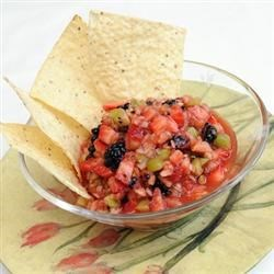 Spicy Fruit Salsa Recipe - A sweet and spicy fresh fruit salsa starring kiwi, strawberries, blackberries, and apples; seasoned with cayenne, hot sauce, green salsa, and lime juice. Serve with tortilla chips