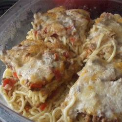 Baked Spaghetti I Recipe - This hearty casserole features ground beef, onion, green pepper, tomatoes and mushrooms simmered into a sauce to layer with cooked spaghetti, Cheddar cheese and cream of mushroom soup. Top with Parmesan and bake for a people-pleasing main dish.