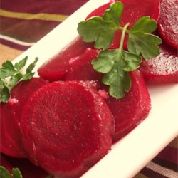 Garlicky Beet Delight Recipe - This is a simple but elegant dish of beets tossed with a tangy garlic vinaigrette dressing.  Feel free to use more than the two cloves of garlic--I do!