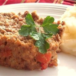 Italian Style Meatloaf I Recipe - Tomatoes, mozzarella cheese and Italian seasonings flavor this ground beef meatloaf. Serve it with buttered pasta and green salad for an easy dinner.
