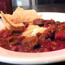 Mexican Mole Poblano Inspired Chili Recipe - Just a bit of cinnamon and chocolate adds the complex flavors of mole poblano to this hearty beef chili.