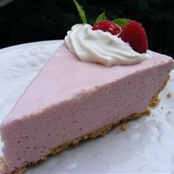 Raspberry Chiffon Pie II Recipe - A lovely fresh raspberry puree is folded into a creamy mousse. The filling is mounded in a graham cracker crust, and then the pie is chilled until it's ready to serve.