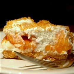 Fresh Peach Dessert Recipe - In this cool, creamy no-bake dessert layers of a whipped marshmallow cream and sweet, ripe peaches sit atop a buttery graham cracker crust.