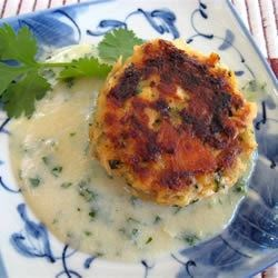 Asian Salmon Cakes with Creamy Miso and Sake Sauce Recipe - A tasty flavorful appetizer, or great as a meal that uses lots of wonderful Asian flavors!  You can also easily substitute for the ingredients and use leftovers too such as corn instead of onions, leftover salmon (BBQ'd, broiled or baked) instead of fresh or canned - and they still turn out great!  A plus crowd pleaser!