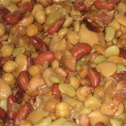 Five Bean Casserole Recipe - Bacon, canned baked beans and seasonings are combined with garbanzo, lima, kidney and butter beans in this sweet and sour casserole.