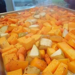 Butternut Squash with Onions and Pecans Recipe - Cubed butternut squash is cooked on the stovetop until tender, then topped with toasted pecans and fresh chopped parsley. The squash can be made ahead and reheated.