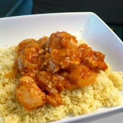 Chicken Tagine with Couscous Recipe - Chicken breast meat simmers slowly with warming spices, dried apricots, and raisins for a savory stew to serve with hot, fluffy couscous. Make it ahead in the slow cooker.
