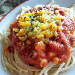 Spaghetti with a Kick Recipe - Add corn, black beans and kidney beans to ready-made spaghetti sauce, then spice things up with cumin and hot pepper sauce. Toss with hot pasta and serve with freshly grated Parmesan.
