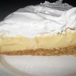 Lemon Lush Pie Recipe - A smooth lemon custard is cooked up until thick and bubbly, and butter, lemon rind and sour cream are stirred in. The sweet tart filling is then spooned into a pre-baked crust and chilled.