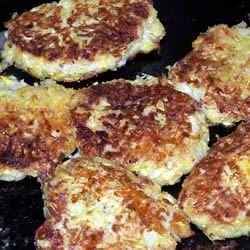 Yellow Squash Patties Recipe - Top these delicious, cheesy squash patties with sour cream and a dash of hot sauce. Everyone will love them!