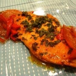 Moroccan Shabbat Fish Recipe - Tilapia is dressed up with red pepper, olive oil, fresh parsley, cayenne, and tomatoes in this Mediterranean-style dish.