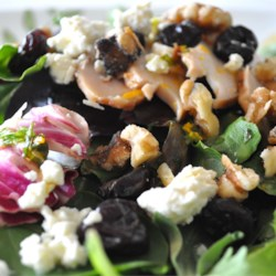 California Cherry and Walnut Salad Recipe - A simple light and sweet salad with goat cheese, dried cherries and walnuts. This dish reminds me of being on the beach.