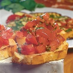 Fantastic Fennel Bruschetta Recipe - French bread slices, brushed with olive oil and toasted until golden brown, get a flavorful topping of fresh tomato, basil, and fennel seeds for a perfect summer appetizer or light lunch.