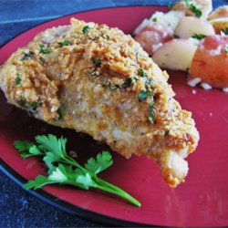 My Mom's Parmesan Chicken Recipe - Parmesan-crusted chicken bathes in butter and white wine for an elegant touch to a family favorite.