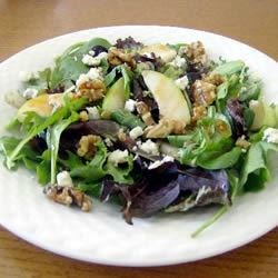 Tangy Pear and Blue Cheese Salad Recipe - Romaine, blue cheese, chopped pears, walnuts, and red onion, combined with a tangy dressing, make this salad unforgettable. It is a sure hit worth trying!