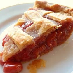 Cherry Pie II Recipe - Although you'll have to pit the cherries for this one, the fabulous results will make it worth your effort. Sugar, flour, butter and cherries are stirred together and poured into a pie shell. Then on goes the lattice top and in goes the pie into the oven.