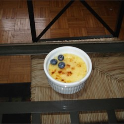 Creme Brulee IV Recipe - Cream is infused with vanilla and then combined with sugar and egg yolks in this traditional stovetop custard that is chilled and then given a burnt sugar top.