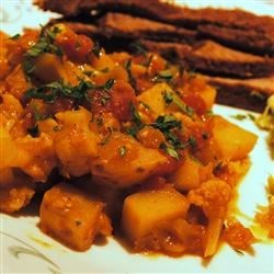 Potatoes Madras Recipe - Great for dinner parties, this colorful and flavorful dish is inspired by southern Indian cooking. Potatoes, cauliflower florets, and red lentils combine with onions, garlic, curry powder, ginger, tomatoes, malt vinegar, and chutney.