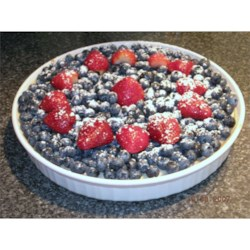 Cheesecake Recipe - A simple cream cheese pie baked in a graham cracker crust and topped with succulent strawberries and blueberries.