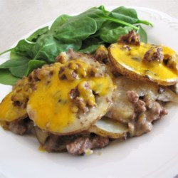Hamburger Potato Casserole Recipe - An oldie but a goodie! A family recipe of ground beef and potatoes layered with mushroom soup and onion, and topped with Cheddar cheese.