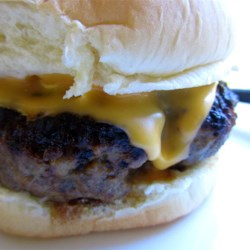 Mini Cheeseburgers Recipe - The cheese is not just on top of these yummy little burgers, it's inside too! They taste great when served on top of hot rice or noodles.