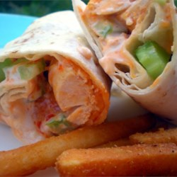 Buffalo Chicken Wraps Recipe - Based on everyone's favorite football food, these Buffalo chicken wraps are sure to be the game-winner for a fun and fast dinner or appetizer!