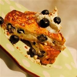 Stuffed Blueberry Toast Recipe - Fresh blueberry sandwiches with a sweet almond and cream cheese filling are dipped in batter and pan-fried until golden brown.